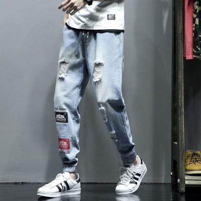 Calça Jeans Rasgada...
