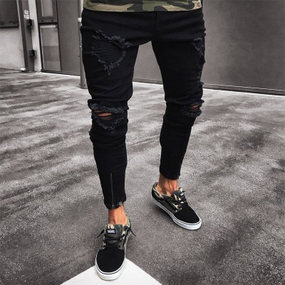Calça Jeans Preta Rasgada...