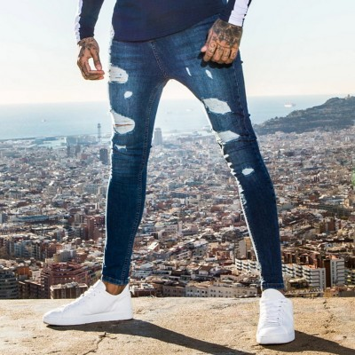 Calça Jeans Rasgada Justa...